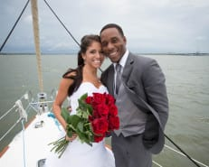 couple getting married on a boat