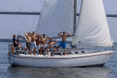 A bachelor party on a sailboat under the Ravenel Bridge in Charleston, SC