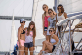 A bridal party on a sailboat under the Ravenel Bridge in Charleston, SC