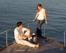 couple romantically talking on a boat