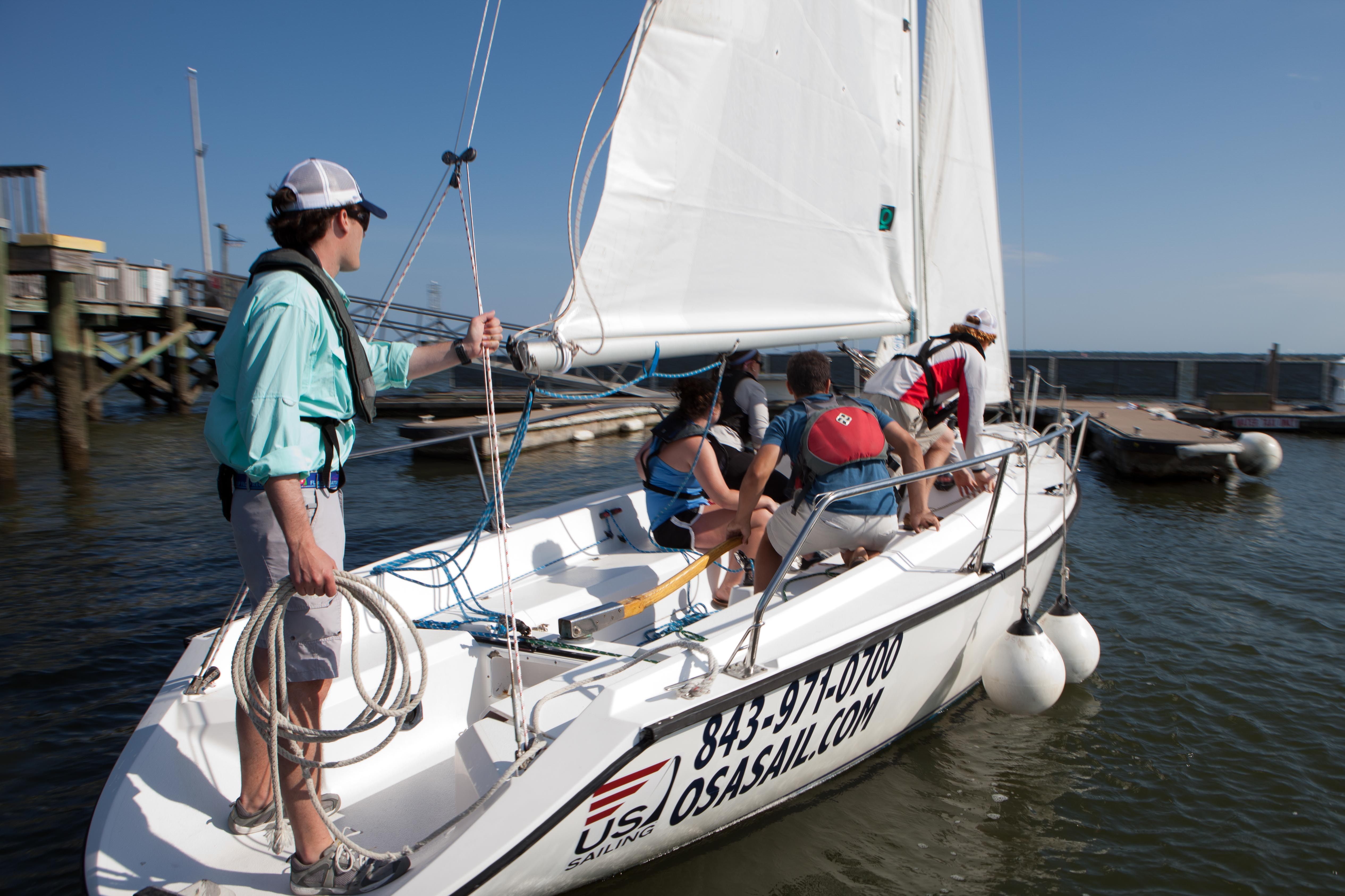 Students approaching the dock on a sailboat